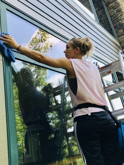 Picture of a woman cleaning window: Kenmure
