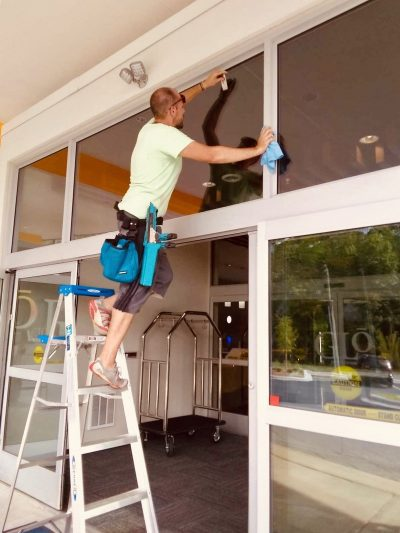 picture of a man cleaning window